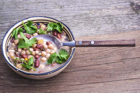 chick pea: Red bean, white bean, urid bean and chick pea soup with fresh coriander leaves. Stock Photo