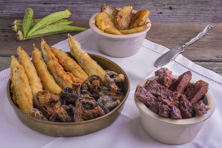 creole: Cajun style  grilled entrecote, with deep fried okra, mushrooms and glazed sweet potatoes
