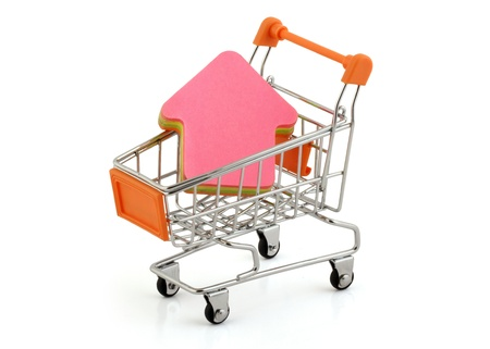 house-shaped post it in the shopping cart,clipping pack photo