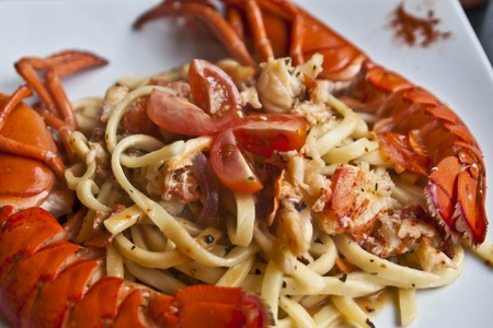 A white dish with spaghetti pasta and lobster photo