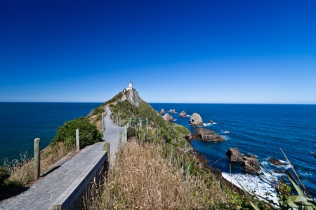Walkway to Nugget Point Lighthouse. New Zealand Stock Photo - 8625857