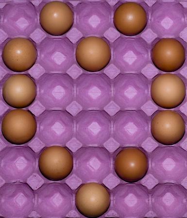 Package of eggs arranged in heart shape photo