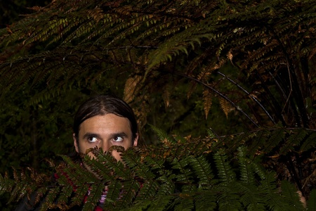 Man hidden in dark deep forest Stock Photo - 8775570