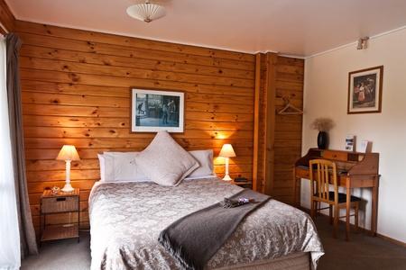 Nice warm bedroom interior of mountain lodge. Fox Glacier Lodge, Fox Glacier, West Coast, South Island, New Zealand. Stock Photo - 8912124