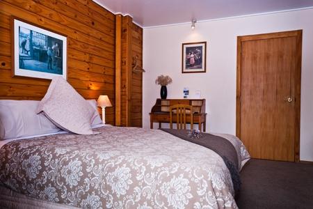 Nice warm bedroom interior of mountain lodge. Fox Glacier Lodge, Fox Glacier, West Coast, South Island, New Zealand. Stock Photo - 8912725