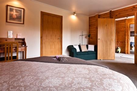Nice warm bedroom interior of mountain lodge. Fox Glacier Lodge, Fox Glacier, West Coast, South Island, New Zealand. Stock Photo - 8912103