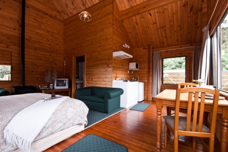 lodging: Nice warm interior of mountain lodge apartment. Fox Glacier Lodge, Fox Glacier, West Coast, South Island, New Zealand. Stock Photo