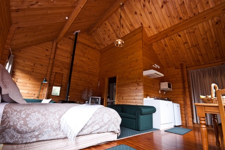 Nice warm interior of mountain lodge apartment. Fox Glacier Lodge, Fox Glacier, West Coast, South Island, New Zealand. Stock Photo - 8912117
