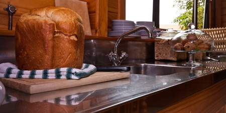 Kitchen and close up of fresh home baked bread. photo