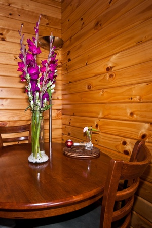 Flowers on the wooden table. photo