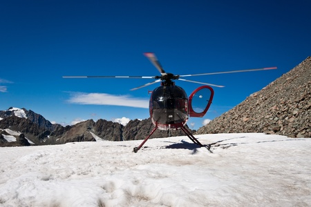 Helicopter on the top of Mount Cook. Southern Alps, West Coast, South Island, New Zealand. photo