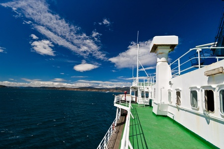 ferryboat: Deck of large ferry with ocean and blue sky. Landscape  composition.