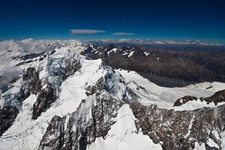 fox glacier: Aerial Southern Alps, West Coast, South Island, New Zealand. Stock Photo