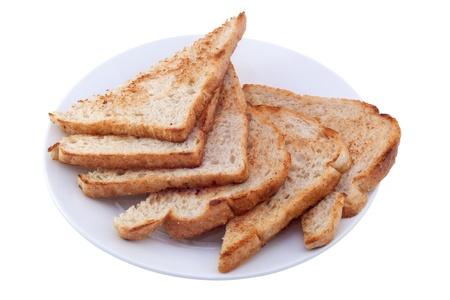 triangle shape: Six pieces of toast on white plate. Image is isolated on white background, contains clipping path.