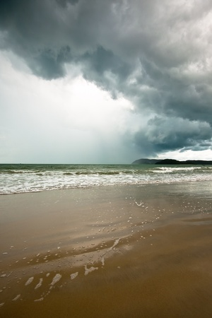 Long sandy golden beach and tropical storm in Langkawi, Malaysia. photo