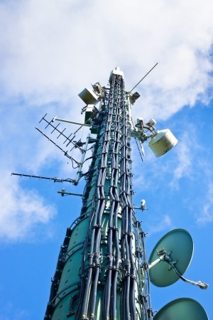 telecommunication equipment: Detail of high telecommunication tower Stock Photo
