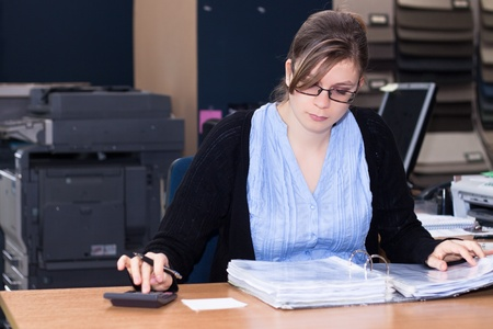 the bookkeeper: Portrait of Young businesswoman working in office.