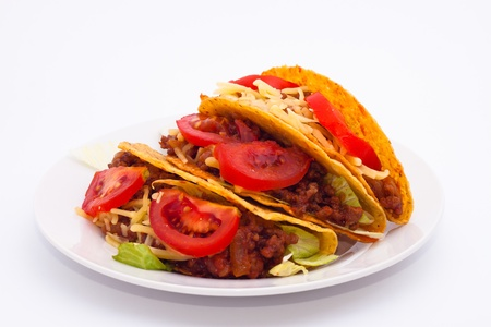 Delicious Mexican tacos on plate, isolated on white background.