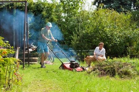 Senior couple working in the garden. Stock Photo