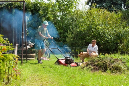 Senior couple working in the garden. photo