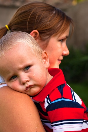 crying boy: Portrait of cute toddler and his mother. Stock Photo
