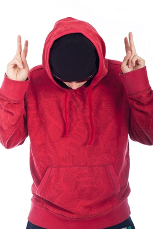raps: Hip Hop man in red hoody posing on white background. Stock Photo
