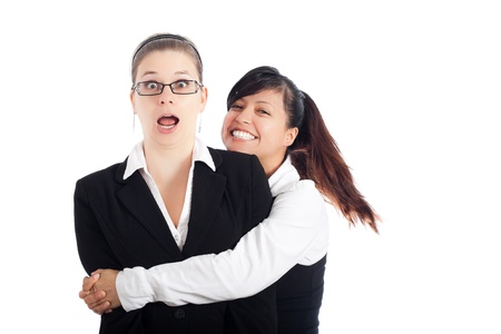 Two excited happy business women humorous moment, isolated on white background. photo