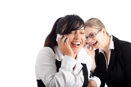 Two young happy business women on the phone, isolated on white background with copy space. photo