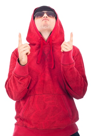 hoody: Hip Hop dancer in red hoody looking and pointing up. Isolated on white background.