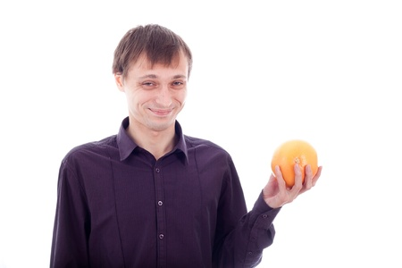 wry: Man wry face grimace holding sour fruit, isolate on white background.