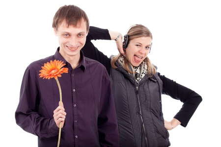 Funny weird couple, ugly man holding flower and rebel woman, isolated on white background. photo