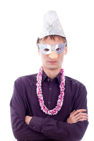 Serious man wearing party mask, isolated on white background. photo