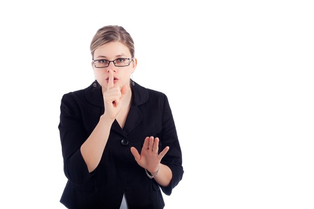 shush: Young business woman gesturing silence sign, isolated on white background. Stock Photo