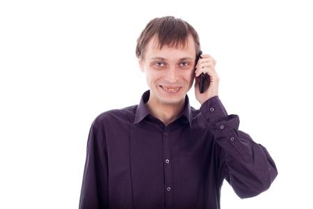 dientes sucios: Feliz hombre raro en el teléfono, aislado en el fondo blanco. Foto de archivo