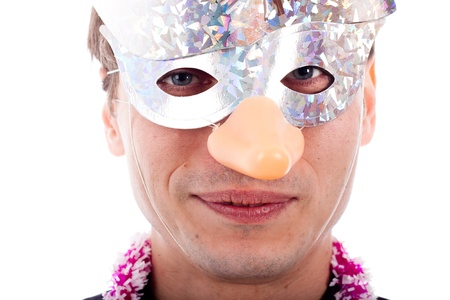 Smiling man wearing party mask, isolated on white background. photo