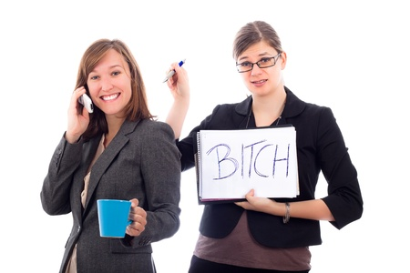 bitch: Two business women colleagues competing concept, isolated on white background.