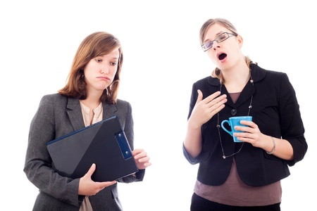 Two tired overworked business women, isolated on white background. Stock Photo - 11979484