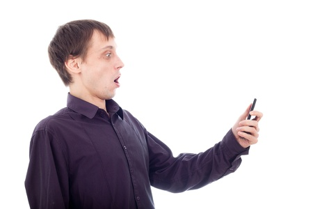 Funny surprised nerd man looking at cellphone, isolated on white background. photo