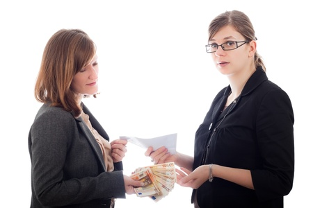bribing: Two young corrupted business women bribe with Euro bank notes, isolated on white background.
