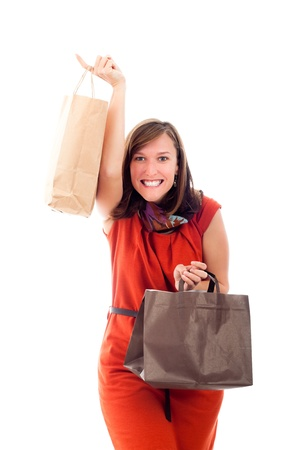 Young excited happy woman shopping, isolated on white background. Stock Photo - 12085484