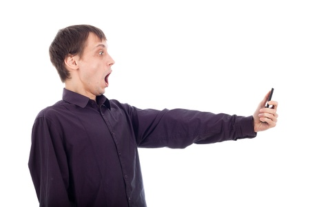 Shocked weirdo nerd man looking at cellphone, isolated on white background. photo
