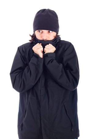 Man wrapped up in winter jacket freezing, isolated on white background. photo