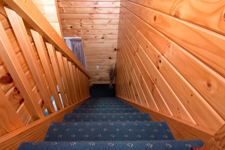 fox glacier: Detail of staircase in wooden lodge apartment. Fox Glacier Lodge, Fox Glacier, West Coast, South Island, New Zealand. Stock Photo