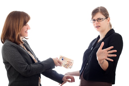 bribe: Two corrupted business women bribe with Euro bank notes, isolated on white background.