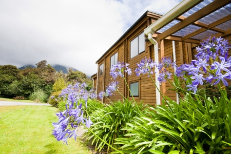 lodges: Mountain lodge exterior. Fox Glacier Lodge, Fox Glacier, West Coast, South Island, New Zealand. Stock Photo