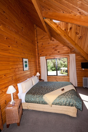 Nice warm interior of mountain wooden lodge double bedroom. Fox Glacier Lodge, Fox Glacier, West Coast, South Island, New Zealand. Stock Photo - 12424432