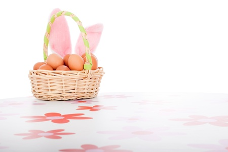 Easter basket with eggs, decoration with copy space, isolated on white background. photo