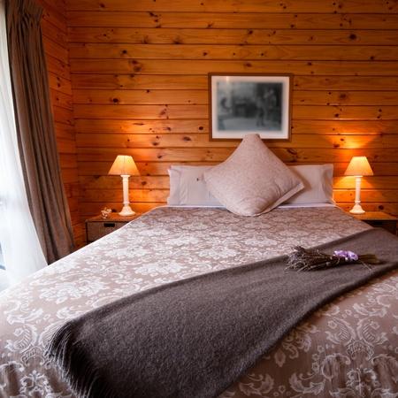Detail of mountain wooden lodge bedroom. Fox Glacier Lodge, Fox Glacier, West Coast, South Island, New Zealand.