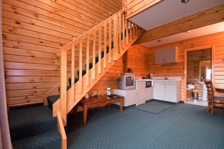 wooden stairs: Lodge apartment interior. Fox Glacier Lodge, Fox Glacier, West Coast, South Island, New Zealand.