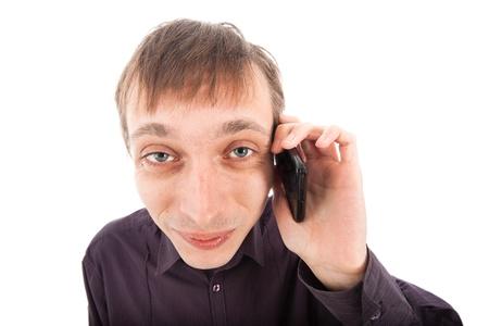Happy weirdo nerd man on the phone, isolated on white background. photo